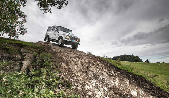 Land Rover Defender off-road on a very steep hill in the Yorkshire Dales